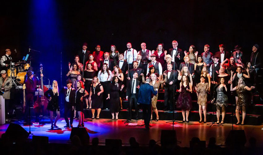 Photo of Revv52 performing at the Bella Concert Hall.